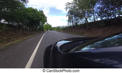 A car on a road trip - A gopro shot that is mounted on a...
