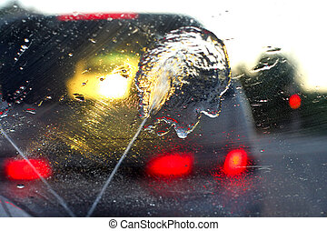 wet windshield - A car through a wet windshield