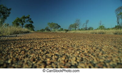 A caravan racing through the outback - A worms eye view of a...