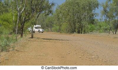 A caravan reversing down a dirt track - A caravan performing...