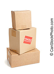 A cardboard moving box with a fragile sticker - a corrugated...