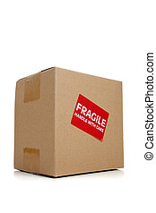 A cardboard moving box with a fragile sticker