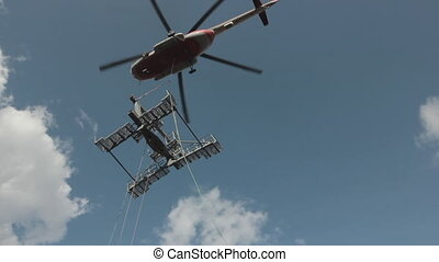 a cargo helicopter establishes a support - A cargo ...