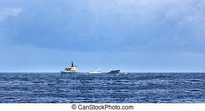 a cargo ship in ocean