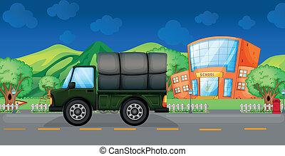 A cargo truck near the school