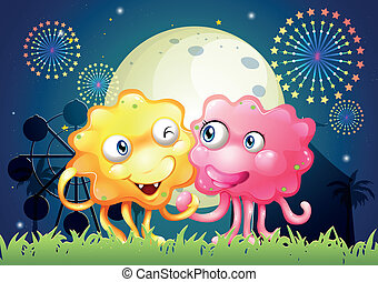 A carnival with a pink and a yellow monster