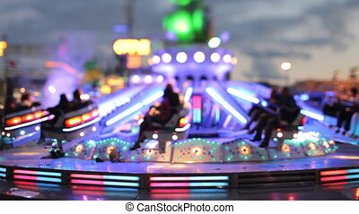 a carousel ride at a carnival in barcelona spain