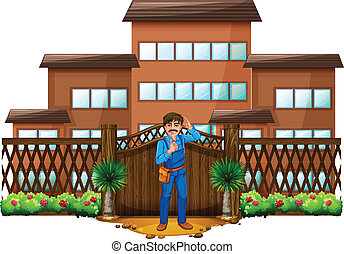 A carpenter in front of the house with a wooden gate