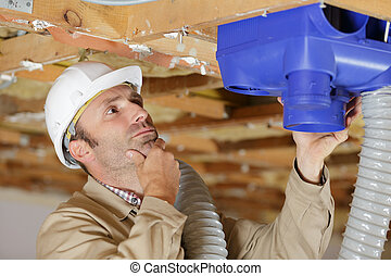 a carpenter on building site