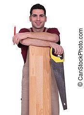 A carpenter ready to saw.