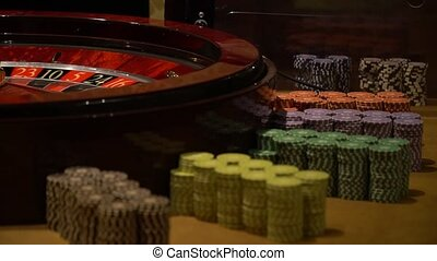casino roulette wheel with the ball on number