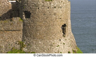 A castle on a coastline - A shot of a castle's tower foot on...