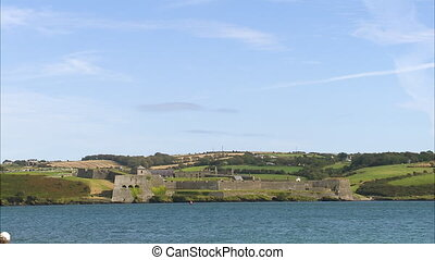A castle on a coastline - A steady scenic shot of an old...