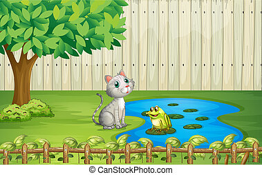 A cat and a frog inside the fence