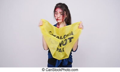 A catalan woman injured in clashes with the police....