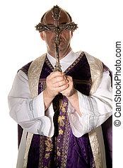 Catholic priest with a cross in worship - a Catholic priest...
