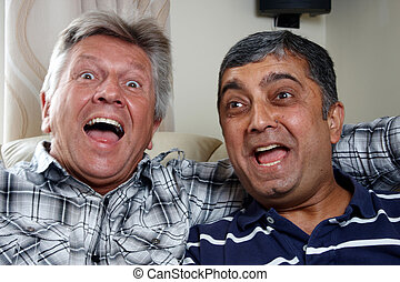 A caucasian and asian man sitting together