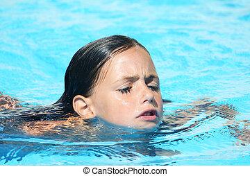 child swimming breast stroke