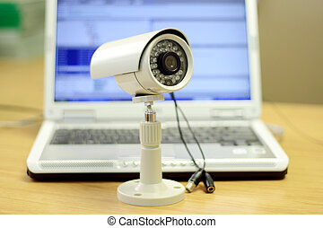cctv camera - a cctv camera in front of a laptop in office
