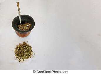 Yerba mate tea infusion and calabash with bombiya isolated on white background. A wooden gourd and the metal straw