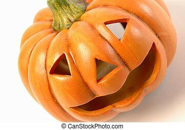 a ceramic halloween jack o lantern diagonal on white background