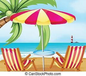 A chair and an umbrella at the beach