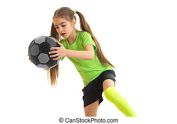 a charming little girl in the Studio holds the ball
