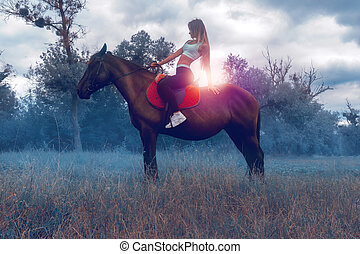 a charming young rider sits astride a horse and looks ahead