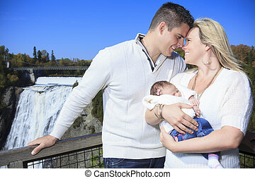 A Cheerful family with waterfall on the background