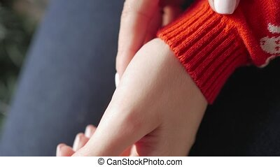 A cheerful girl in a woolen red sweater in the home. Cold weather.
