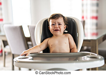 cheerful happy baby child sitting in chair