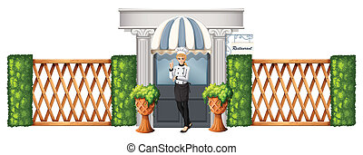 A chef in front of the restaurant with wooden fence