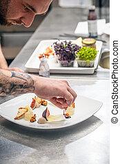 A chef preparing appetizer