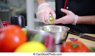A chef working in the kitchen. Making a salad