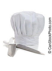 A chef's hat with cooking knifes