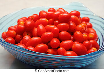 Cherry tomato in the glass bowl