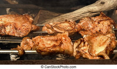 a chicken grill - the chicken meat roasted on the skewer