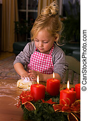A child at Christmas in Advent when baking cookies - Child...