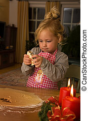 A child at Christmas in Advent when baking cookies