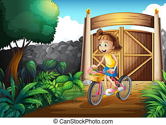 A child biking at the yard