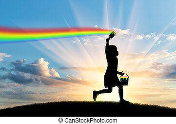 A child draws a rainbow in the sky