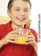A child drinking orange juice