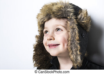 child in fur Hat fashion casual winter style little boy