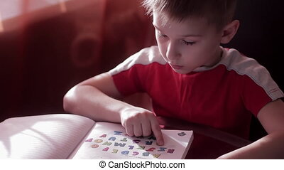 A child learns to read in home