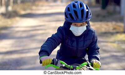 A child on a walk near the house during the quarantine ...