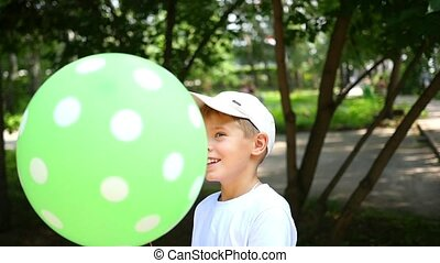 a child playing in the Park with balloon