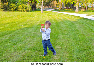A child playing with a ball in the park