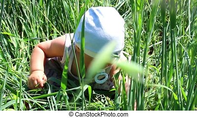 a child plays in a field of grain