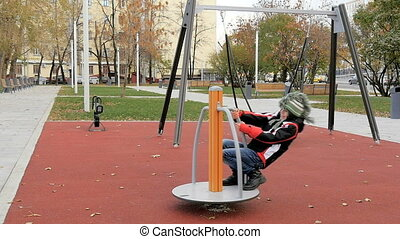 A child plays on the playground, slow motion.