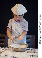 a child plays with the flour
